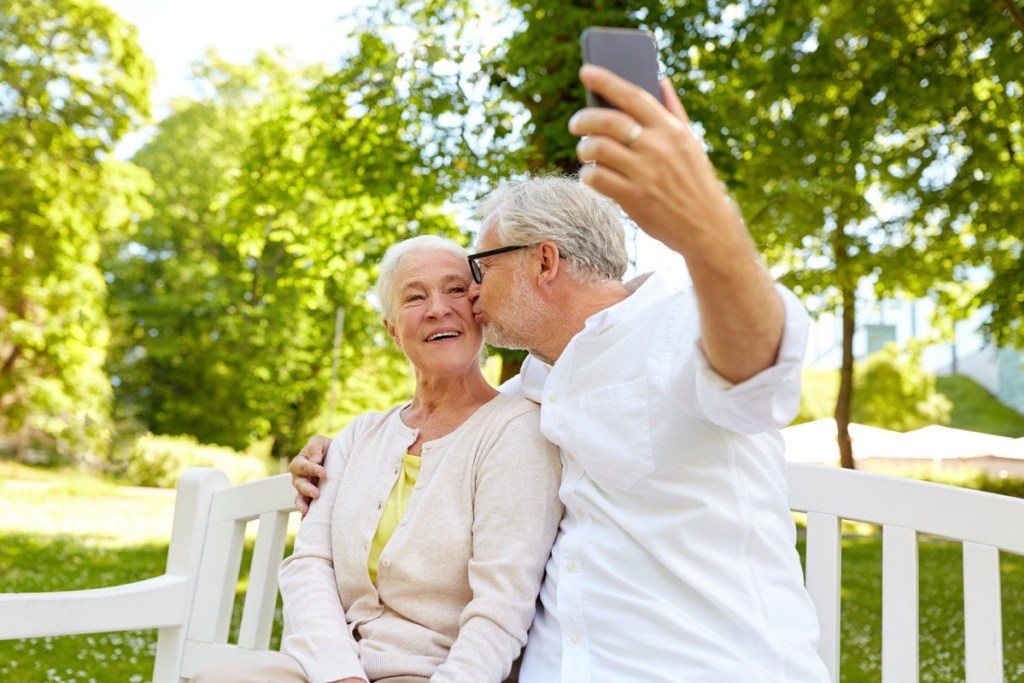 """Older Couple Taking a Selfie Photo {Find Happiness}"""" width=""""1024"""" height=""""683"""" srcset=""""https://i2.wp.com/bestlifeonline.com/wp-content/uploads/2018/11/old-couple-selfie.jpg?resize=1024%2C683&ssl=1 1024w, https://i2.wp.com/bestlifeonline.com/wp-content/uploads/2018/11/old-couple-selfie.jpg?resize=500%2C333&ssl=1 500w, https://i2.wp.com/bestlifeonline.com/wp-content/uploads/2018/11/old-couple-selfie.jpg?resize=768%2C512&ssl=1 768w, https://i2.wp.com/bestlifeonline.com/wp-content/uploads/2018/11/old-couple-selfie.jpg?w=1200&ssl=1 1200w"""" sizes=""""(max-width: 1000px) 100vw, 1000px"""" data-recalc-dims=""""1"""