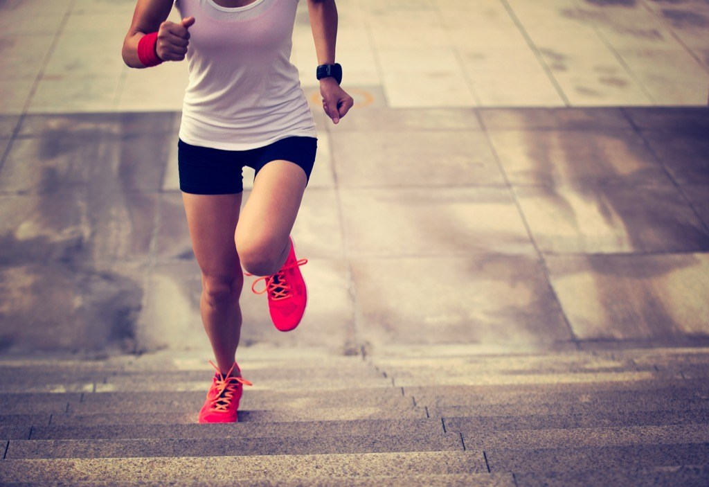 """Woman Running Up the Stars {Weight Loss Secrets}"""" width=""""1024"""" height=""""703"""" srcset=""""https://i1.wp.com/bestlifeonline.com/wp-content/uploads/2018/01/woman-sprinting-running-up-stairs.jpg?w=1024&ssl=1 1024w, https://i1.wp.com/bestlifeonline.com/wp-content/uploads/2018/01/woman-sprinting-running-up-stairs.jpg?resize=500%2C343&ssl=1 500w, https://i1.wp.com/bestlifeonline.com/wp-content/uploads/2018/01/woman-sprinting-running-up-stairs.jpg?resize=768%2C527&ssl=1 768w, https://i1.wp.com/bestlifeonline.com/wp-content/uploads/2018/01/woman-sprinting-running-up-stairs.jpg?resize=266%2C182&ssl=1 266w, https://i1.wp.com/bestlifeonline.com/wp-content/uploads/2018/01/woman-sprinting-running-up-stairs.jpg?resize=600%2C411&ssl=1 600w"""" sizes=""""(max-width: 1000px) 100vw, 1000px"""" data-recalc-dims=""""1"""