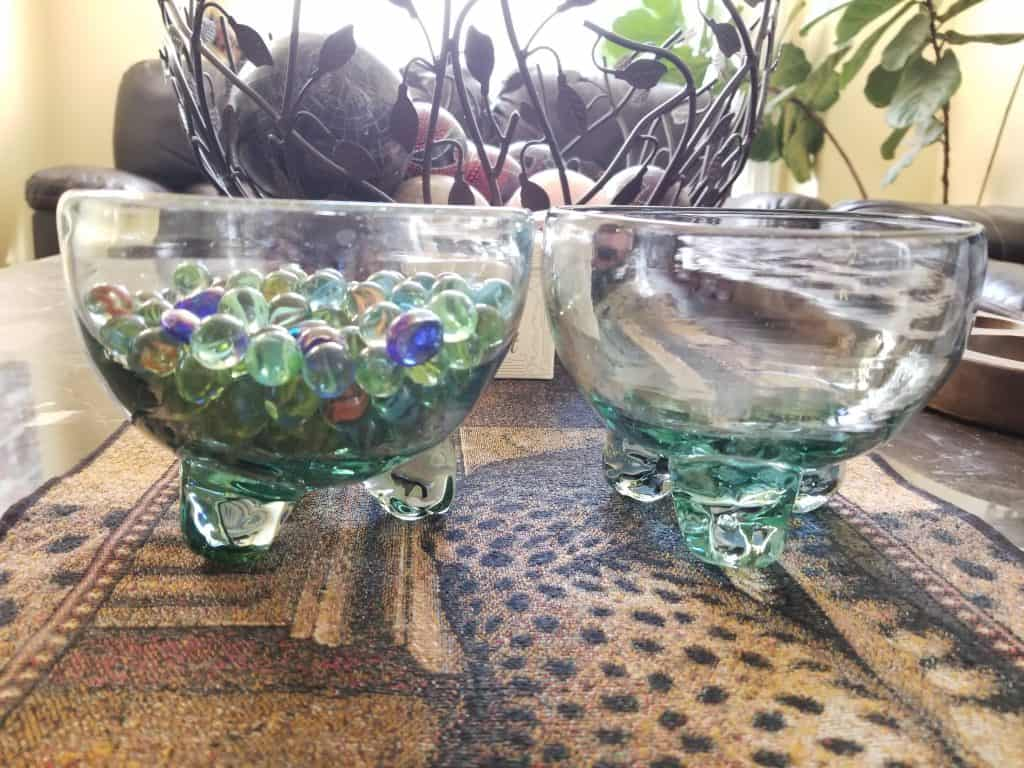 Two bowls of marbles.