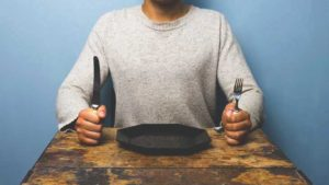 Man Sitting At Table With Empty Plate Thumb.jpg