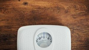 Scales On Wooden Surface Thumb.jpg